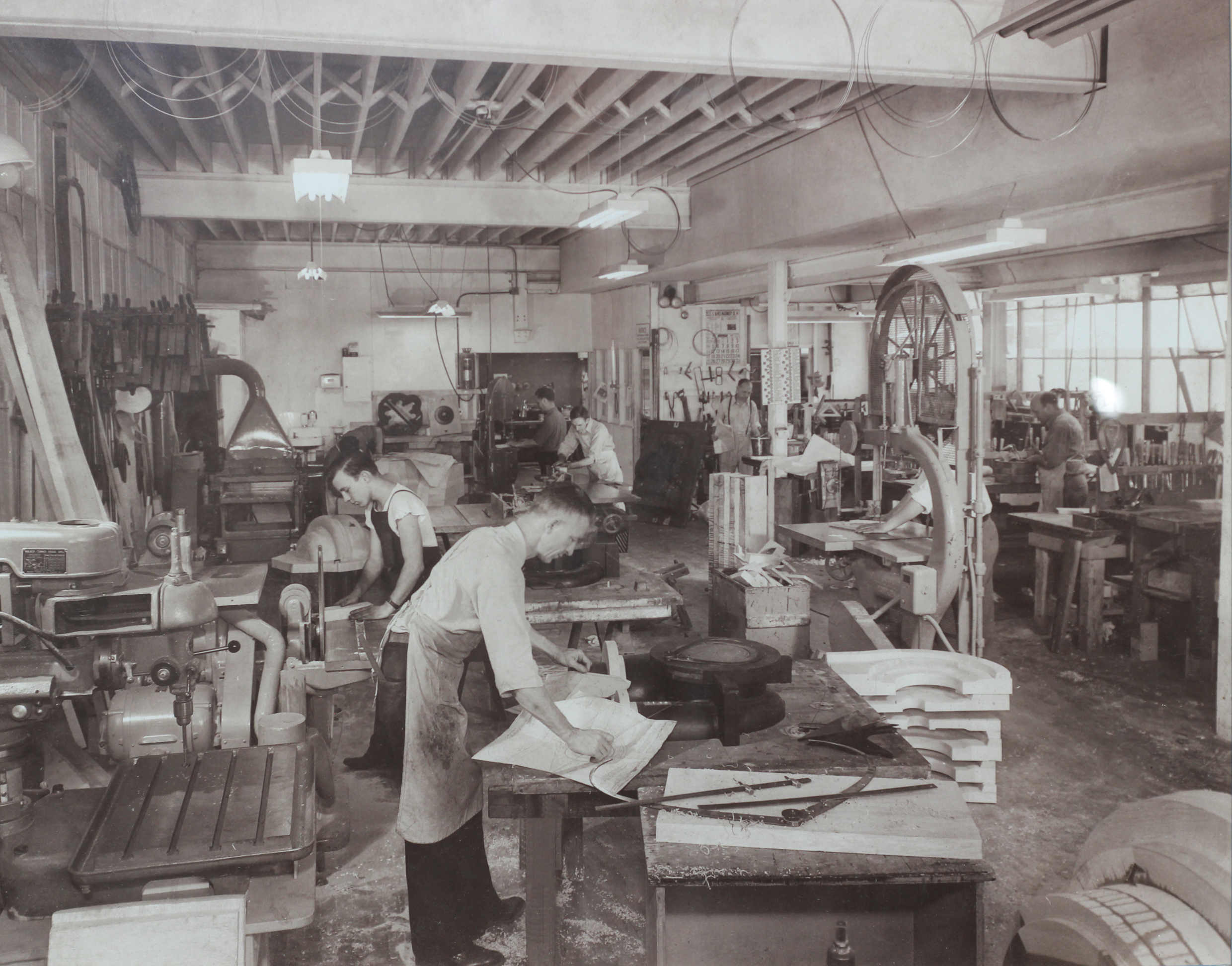 Old photo of workers in a pattern shop